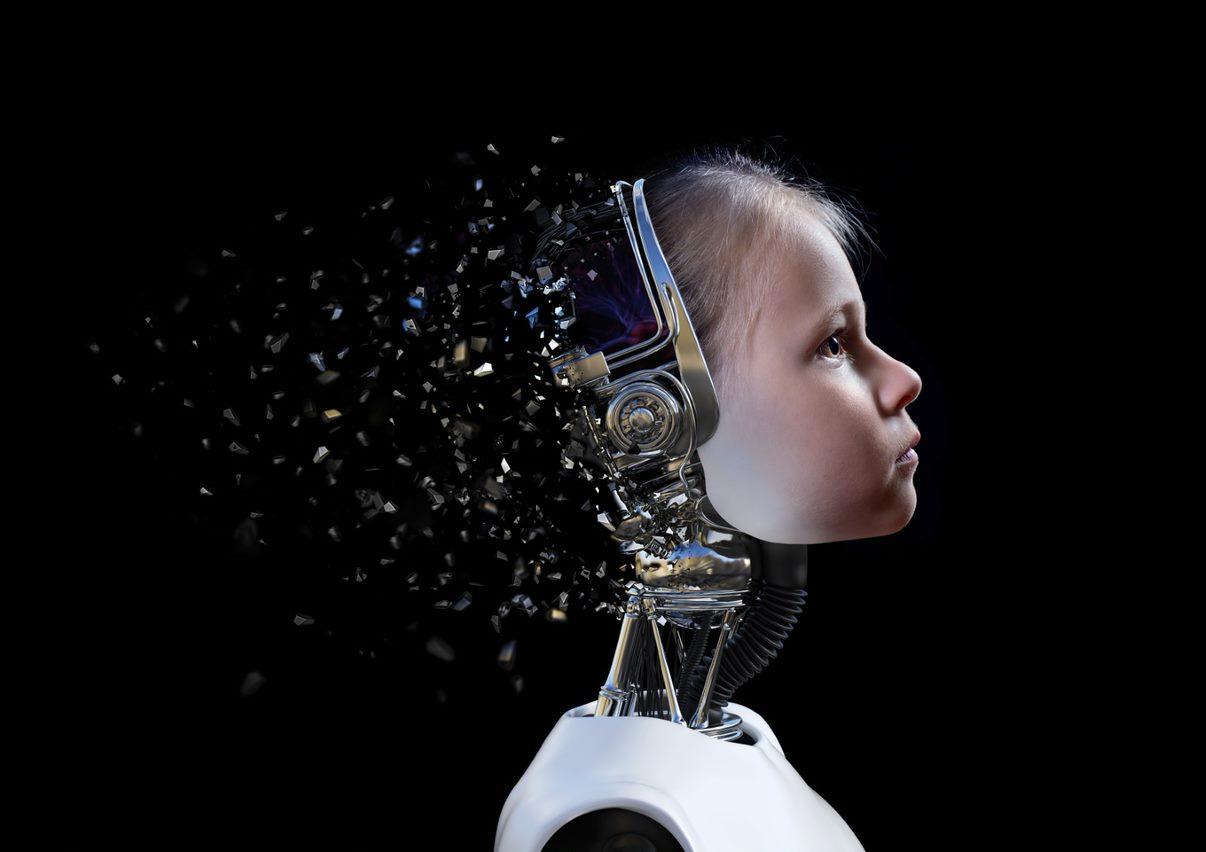 Kuva Outouden laakso-teoksesta. Tausta on miusta. Ihmislapsen kasvot ovat osana robottia ja pään takaosassa näkyy kuin metallisia sirpaleita, jotka leviävät mustaa taustaa vasten.
