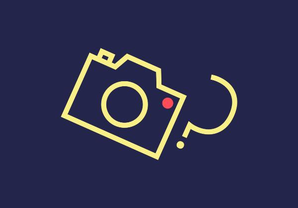 Kuvassa tummansinisellä pohjalla keltaisella piirroskuva kamerasta, jonka vieressä kysymysmerkki